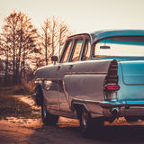 Old retro or vintage car back side. Vintage effect processing Royalty Free Stock Photo