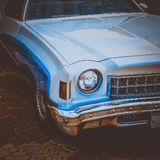 Old retro or vintage car front side. Vintage effect processing Stock Image
