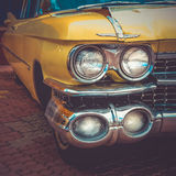 Old retro or vintage car front side. Vintage effect processing Stock Photography