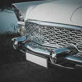 Old retro or vintage car front side. Vintage effect processing Royalty Free Stock Images