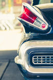 Old retro vintage classic black chromed car park at petrol station in Woking UK. stock photography
