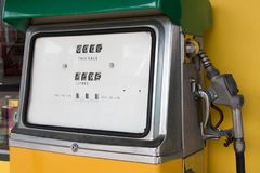 Old retro vintage oil pump station or oil dispenser in petrol station. Close up of vintage old station with pump and copy space for text and background royalty free stock photography