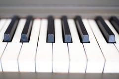Old piano keys up close royalty free stock photo