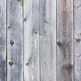 Old retro vintage rustic weathered wooden background. Old retro vintage rustic weathered wooden background with knots. Wood plank brown texture Royalty Free Stock Images