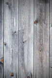 Old retro vintage rustic weathered wooden background. Old retro vintage rustic weathered wooden background with knots. Wood plank brown texture Royalty Free Stock Photo