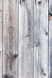 Old retro vintage rustic weathered wooden background. Old retro vintage rustic weathered wooden background with knots. Wood plank brown texture Royalty Free Stock Photos