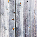 Old retro vintage rustic weathered wooden background. Old retro vintage rustic weathered wooden background with knots. Wood plank brown texture Stock Photography