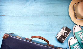 Old retro vintage suitcase and camera tourism travel background. Concept Stock Photos