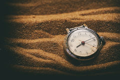 Old retro watch on sand Stock Images