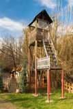 Old retro watch tower out in a park. Stock Image