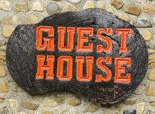 Old retro wood sign with the text Guest house. Old retro wood sign with the text Guest house in Thailand Royalty Free Stock Photos