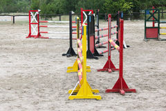 Old retro wooden barriers on the ground for jumping horses and riders Stock Image