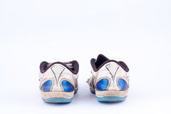 Old retro worn out futsal sports shoes  on white background  isolated  back view Royalty Free Stock Photos