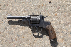 Old revolver. Lying on a concrete Royalty Free Stock Photos