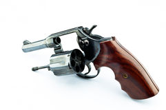 Old revolver with bullets. On white background stock photography