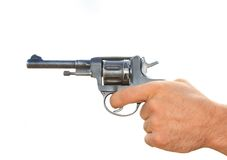 Old revolver in a hand isolated Stock Photo