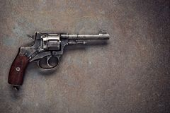 Old revolver on a dark background. Old revolver on  vintage dark background Stock Image