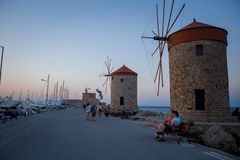 Old Rhodes windmills in Mandraki port stock image