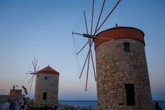 Old Rhodes windmills in Mandraki port stock photography