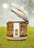 Old rice Cooker with field background Stock Photos