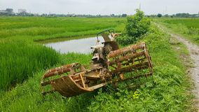 Old Rice Harvester in Vietnam royalty free stock photography