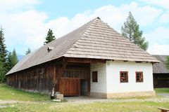 Old rich white village house in open-air museum. Old rich white village house with shingles roof in open-air museum Liptov Village Museum Pribylina in Slovakia Royalty Free Stock Photos