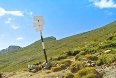 An old rickety signpost direction white sign arrow near the trac Royalty Free Stock Photos