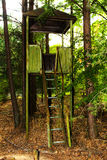 The old rickety watchtower of a soldier. Dead military unit. Royalty Free Stock Images