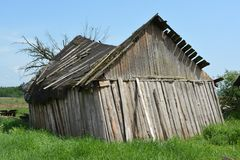 Old rickety wooden barn after the strong wind royalty free stock photo