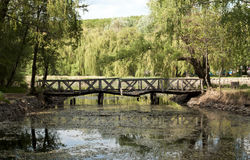 Old rickety Wooden Bridge in Hungary. Old rickety Wooden Bridge over the Lake Royalty Free Stock Photography