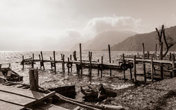 Old rickety wooden piers out into Lake Atitlan in Guatemala in black and white Stock Photo