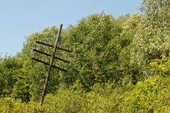 Old rickety wooden telegraph pole Stock Photo