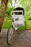 Old Rickshaw. Rusty white ricksha at a tropical resort in India Stock Photography