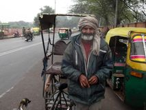 Old rickshaw driver on bike. Bicycle Indian rickshaw driver in New Delhi India Asia Royalty Free Stock Photography