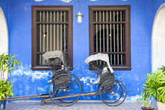 Old rickshaw tricycle near Fatt Tze Mansion or Blue Mansion, Malaysia Royalty Free Stock Image