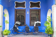 Old rickshaw tricycle near Fatt Tze Mansion or Blue Mansion, Penang Stock Photos
