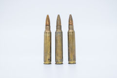 Old rifle cartridges 5.56 mm on a white background Royalty Free Stock Photo