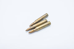 Old rifle cartridges 5.56 mm on a white background Royalty Free Stock Images