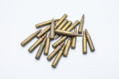 Old rifle cartridges 5.56 mm on a white background Royalty Free Stock Photography
