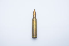 Old rifle cartridges 5.56 mm on a white background Stock Photo