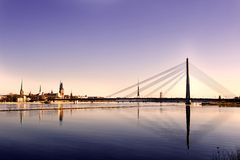 Old Riga, Latvia. Classic view of Old Riga in Latvia. Cable-stayed bridge over the river of Daugava and Riga castle with Riga Cathedral in a front. TV tower royalty free stock photos