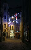 The old Riga street with christmas light decoration Stock Photos
