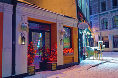 Old Riga street decorated with Christmas lights Royalty Free Stock Images