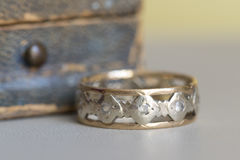 An old ring. An old gold and silver ring with a ring box in the background Royalty Free Stock Image