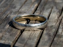 Old ring on a wooden board royalty free stock images
