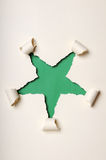 Old Ripped Paper Forming Star Royalty Free Stock Photos