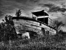 Old river boat. Old,rusty and abandoned river boat  in B/W technique Stock Image