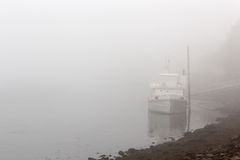 Old river boat in a misty morning Stock Image