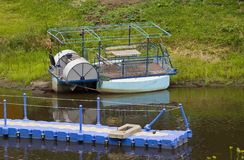 Old river pontoon boat Stock Photography