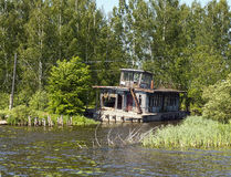 Old river pontoon house Royalty Free Stock Photo